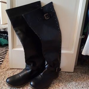 Long black boots with buckle and studs